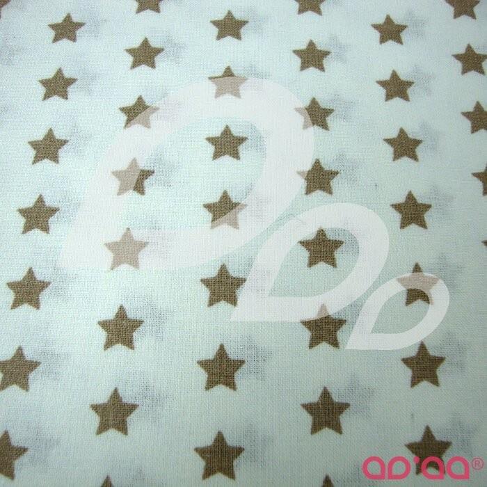 Tecido de Algodão com Estrelas Creme e Fundo Branco