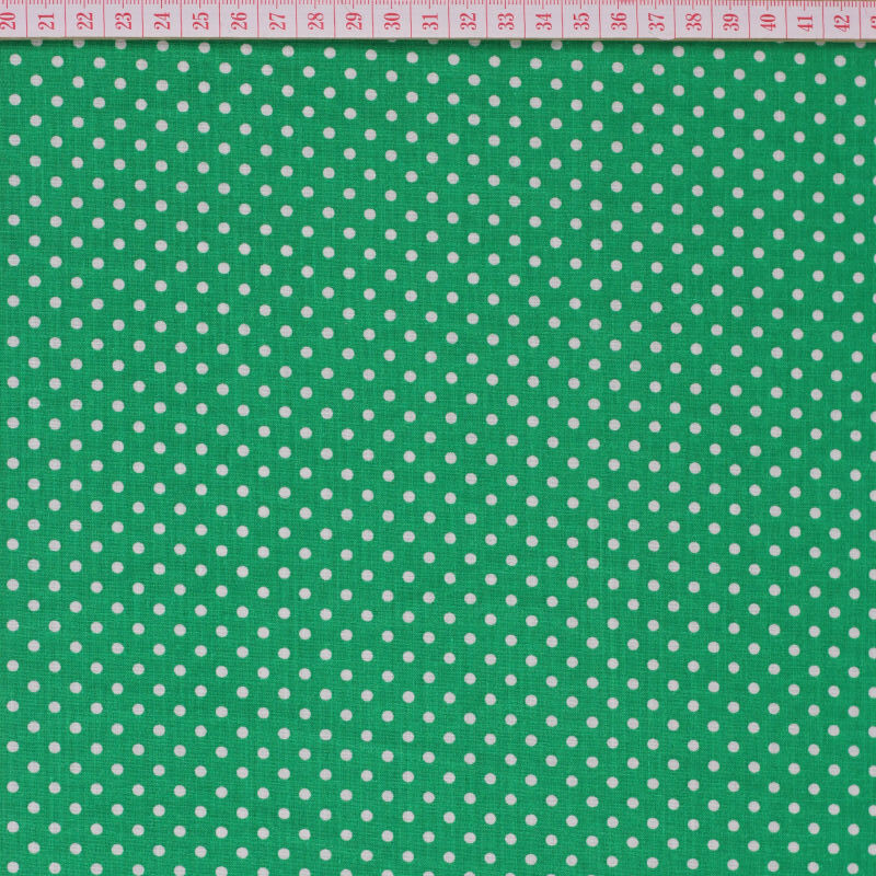 White dots in green